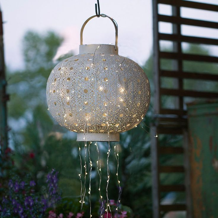 Weave lights through a lantern to create a soft, overhead light source.