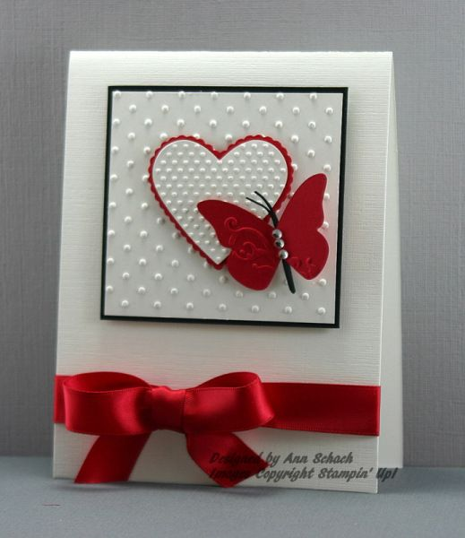 "Butterflies of the Heart--Card Stock: Whisper White, Basic Black, Real Red; Tools: Big Shot, Perfect Polka Dots Textured Impressions Folder, Scalloped Heart of Hearts Embosslits, Beautiful Wings Embosslits, Full Heart Punch; Glitz and Glam: Clear Rhinestone Brads, Real Red 5/8"" Satin Ribbon"
