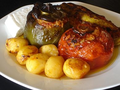 Greek Stuffed Vegetables (Gemista) - This is a very popular dish in the summer. Although stuffed peppers and tomatoes are well enough known, usually we also have stuffed eggplant and zucchini. They are accompanied by potatoes and can also be accompanied by Feta cheese.
