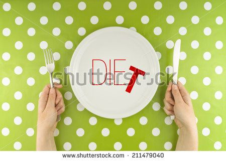 Top View of Female hands at dinner table holding fork and a knife above plate as dieting concept. Word Diet becoming Die referring to health issues that diet mistakes can cause. - stock photo
