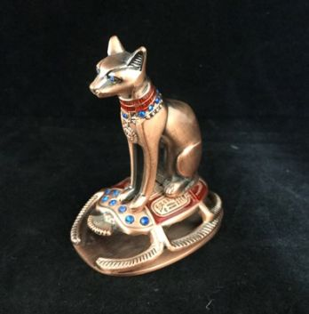 Bastet Statue sitting on a Scarob - in brushed Bronze coloured, resin with red & blue decoration. Approx 8cm high.  Made in Egypt