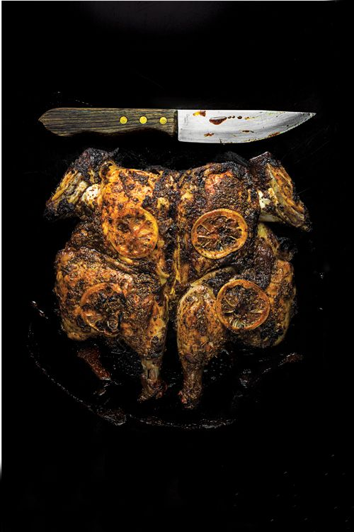 Adobo Chicken Under a Brick. Maricel Presilla's zesty Cuban-inspired marinade infuses the chicken with flavor, and grilling it flat on a plancha (griddle) results in delicious crispy skin.