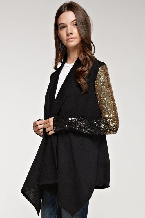 Eeek! We LOVE this sequin cardigan! Our Free With Me knit cardigan features an extended length with waterfall hemline and...