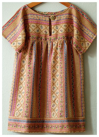 From Alicia Paulson's blog. It is just three rectangles. Made one for A last year, it was easy for a dress. I would like to make one for her for every summer (myself too, if I get that far).