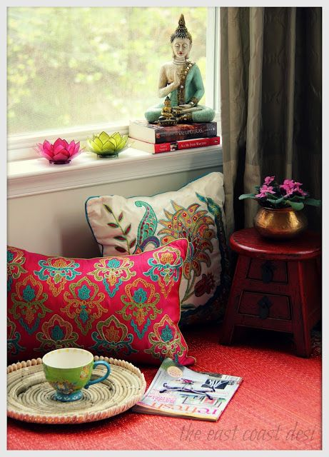 To create a serene spot in your home, bring in oriental floral, a Buddha statue, a few leafy stem and books!