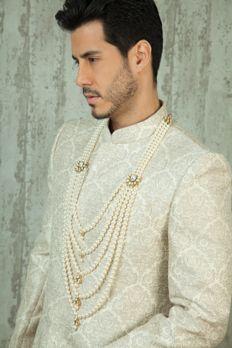 Pearl mala with vilandi side brooch from #Benzer #Benzerworld #men #wedding #accessories #malas