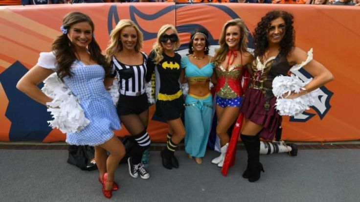 Week 8 of the 2016 NFL season (except Thursday and Monday nights) was played the day before Halloween, so many people around the country wore costumes to games, as did the Denver Broncos cheerleaders. There was a Waldo, a Wonder Woman, a skeleton, a Batgir, a Mario, a Dorothy, a leopard, a referee and more. There was also one True Genius in a full-on inflatable dinosaur costume. First of all: A-plus costume choice. Just terrific work. But not only did this cheerleader pick a great costume…