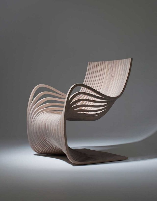 """For the Guatemalan brand Piegatto, designer Alejandro Estrada has imagined """"The Pipo Chair"""" : a plywood chair which curves and different layers wave in an elegant way. 29 wooden strands were cut from only two pieces of plywood to build these chairs available in several colors."""
