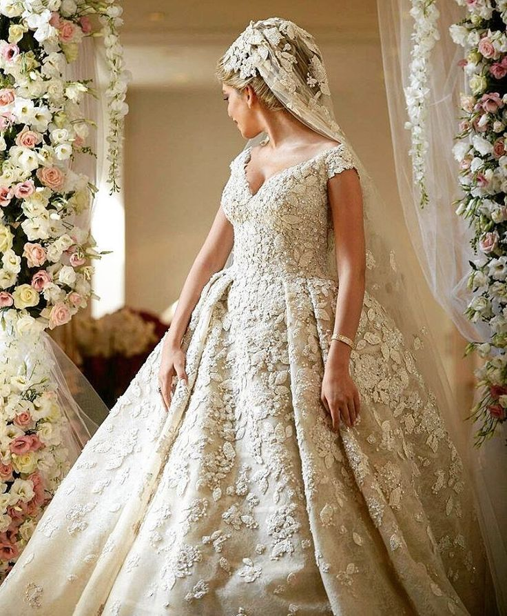 This haute couture off the shoulder wedding gown is ornate for Haute couture price range