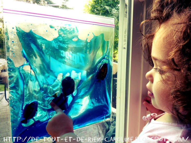 Tactile ocean bag. It's a freezer Ziploc bag filled with corn syrup then add blue food dye mix well and then add in your fish and sea life. Tape with box tape to a window and let the kids have a blast!