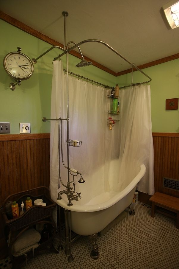 Restored bath includes a cast-iron claw-foot reproduction tub.
