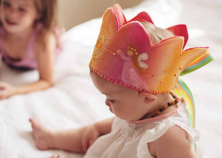 baby in her birthday crown
