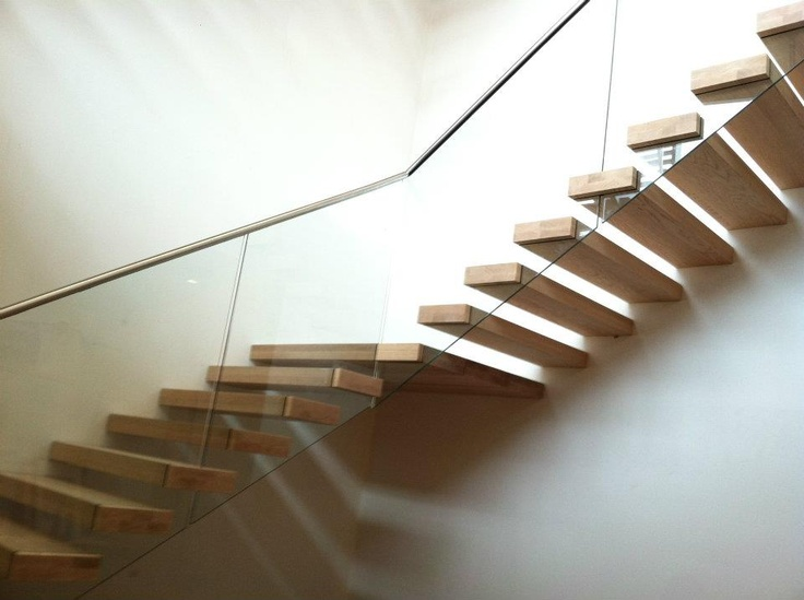 An EeStairs Installation Featuring Floating Oak Treads Supporting A Glass  Balustrade.