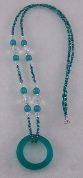 """""""Teal"""" Eyeglass Holder....glass seed beads, glass beads, sterling silver beads, and sterling silver clasp.  Place the stem of glasses through hoop and fold glasses!  www.moongoddessjewelry.com"""