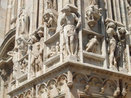 Carvings on the cathedral walls in Piazza Duomo, Milan.
