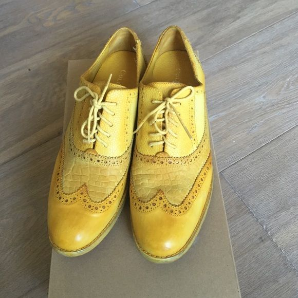 "New Cole Haan yellow wingtip women's oxfords 8.5 Stylish statement shoes!!! New Cole Haan yellow wingtip women's oxfords. They come with box. Excellent condition. Worn once. They have the ""memory foam"" Cole Haan inserts for the feet so they're very comfortable!! Cole Haan Shoes Flats & Loafers"