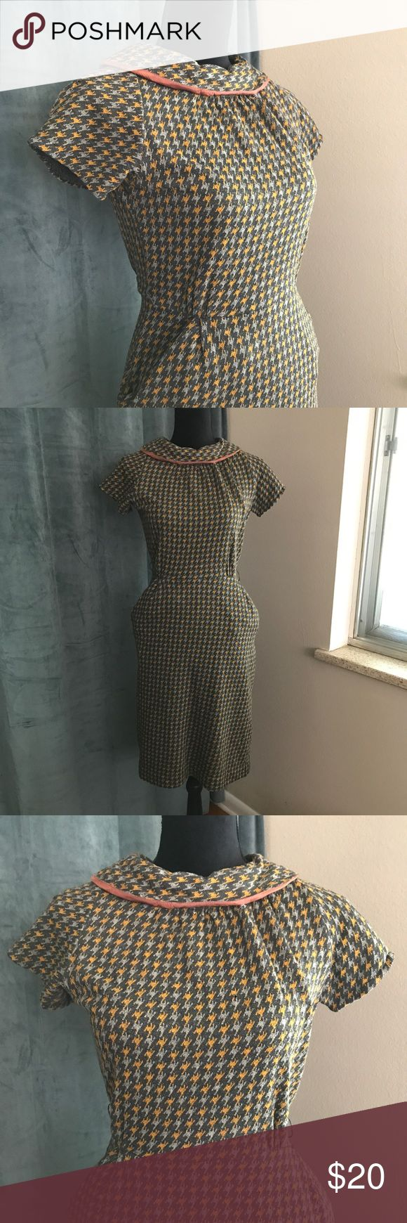 """Vintage 50s Grey Houndstooth Day Dress M Vintage 50s grey and gold houndstooth woven day dress with pockets.  Condition: There is a pinhole in the front of the bodice (see photo). Normally I wouldn't sell this but it would make a great Mad Men costume piece or could be repaired. It's too cute to send to thrift. Other than that, condition is great.  Waist: 30"""" Bust: 38"""" Hips: 40"""" Length (from shoulder): 39"""" Vintage Dresses Midi"""