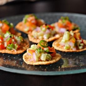 Fried mini papads loaded with Indian style spicy cucumber, onion, tomato salad.