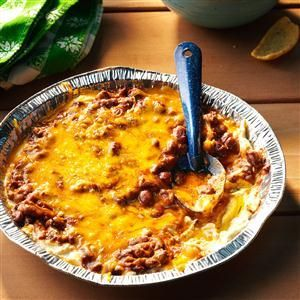 Campers Favorite Dip Recipe -Our family craves this cheesy chili dip so much we make two batches, especially for the guys. If you're not grilling out, bake it in the oven. —Valorie Ebie, Bel Aire, Kansas