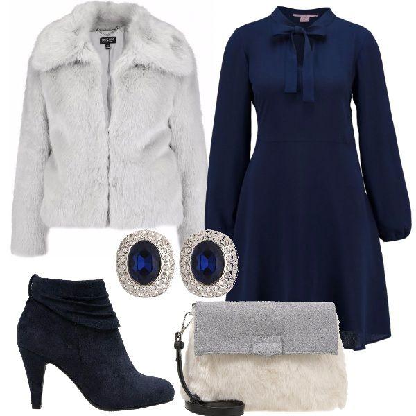 Per questo outfit: vestito blu scuro con fiocco al collo, tronchetto blu scamosciato, pellicciotto grigio chiaro, borsetta fur grigio e bianca e orecchini brillanti a impreziosire il look.