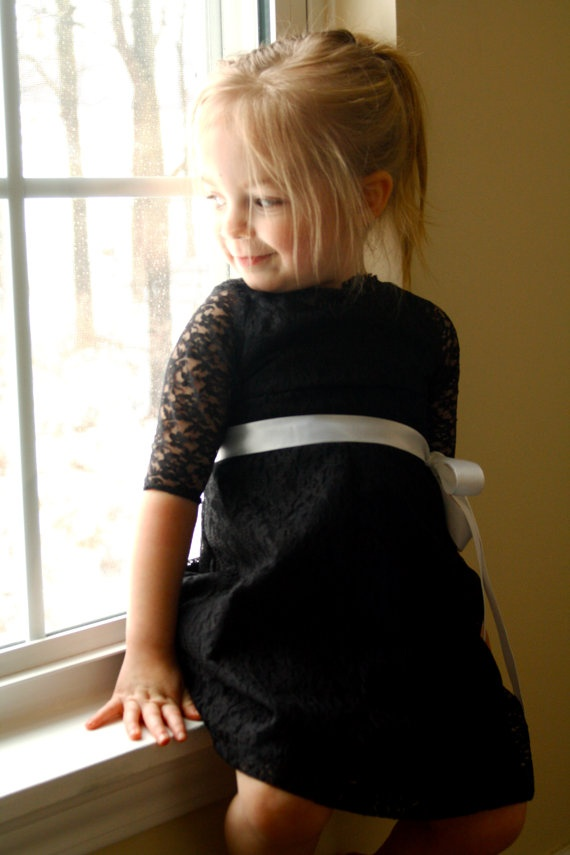 This black lace dress looks so cute on her.