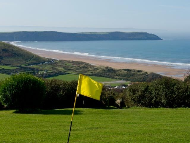 Take in the beach views while playing a round of golf.  Woolacombe Bay Holiday Park   https://www.campsitechatter.com/campsites/pinboard/Woolacombe-Bay-Holiday-Park/5772229778202191281