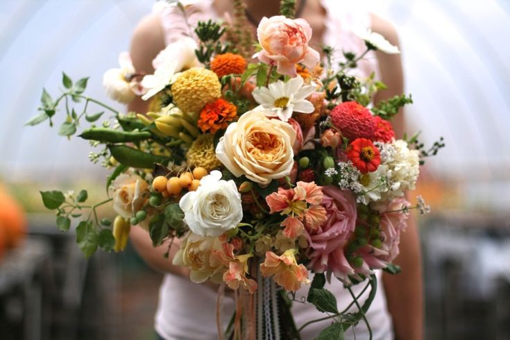2015 Wedding floral trend: edible infused bouquets.   Riding on the coattails of the local, seasonal flower movement and appealing to foodies and locavores alike is the increasing interest in incorporating fruits and other edibles into floral designs. We'll see more herbs and fruiting vines such as thornless raspberries and unripened strawberries tucked into bridal bouquets, adding texture, style and sophistication. Click through to read more about 2015 trends.  #farmerflorist