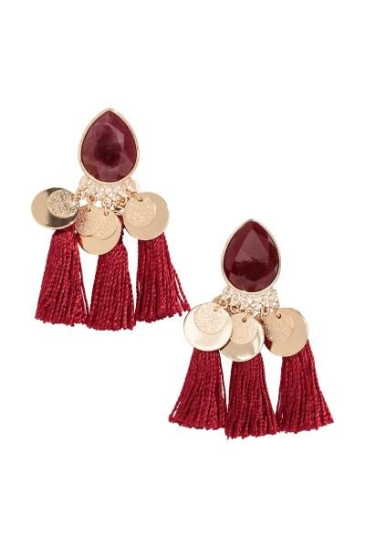 Large metal earrings with tear-shaped plastic beads and fabric tassels. Length 7 cm.