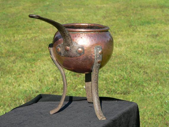 Antique rustic arts & crafts hand beaten or hammered copper cauldron pot / saucepan on iron legs. Thick copper bowl with iron handle.