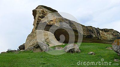 A large stone slab lying on the grass
