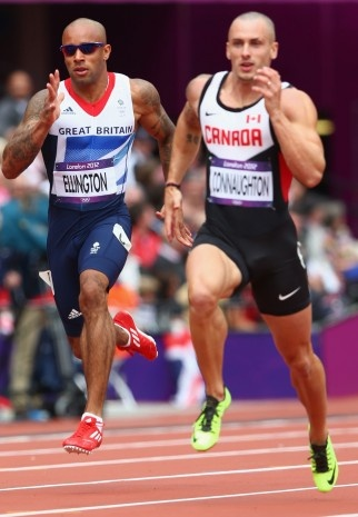 Great Britain's James Ellington, left, and Charlottetown's Jared Connaughton race in a men's 200-metre heat at the Olympic Stadium. August 8.