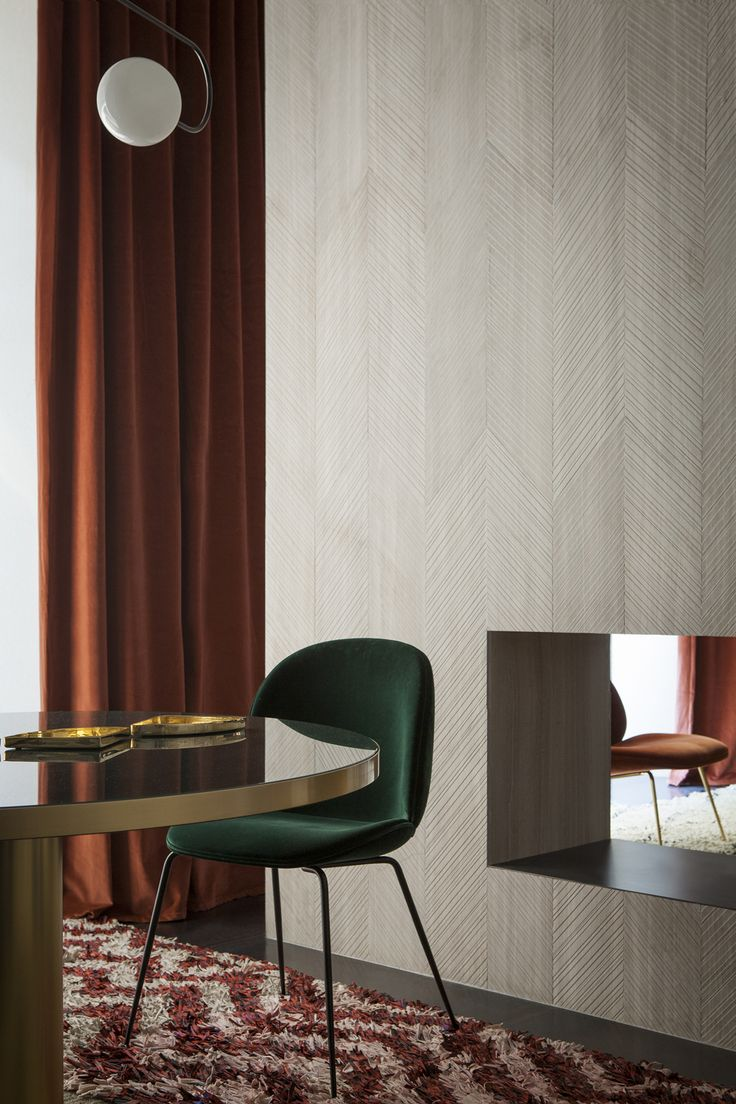 The Studiopepe-designed installation focuses on of-the-moment trends — layered Berber carpets, pops of rust and dark green, and tons and tons of velvet.