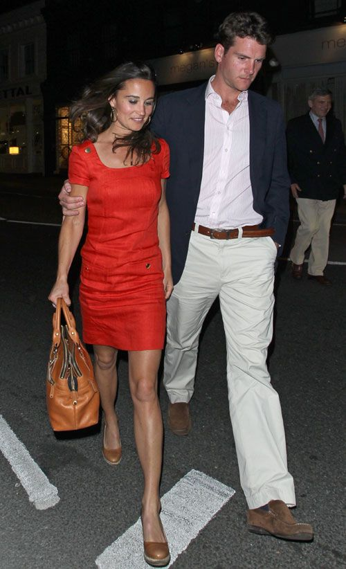 Pippa in a red, Hobbs shift dress and brown wedge heels with Alex Loudon