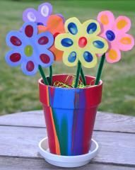 Thumb Print Flowers Cut flower petals out of construction paper, using a stamp pad or paint, have students paint the flower with their thumb prints and plant the bouquet in a terra cotta pot that they painted.