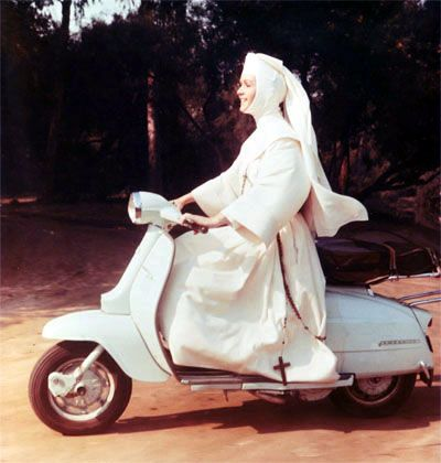 Lambretta. Mind your crusafix or however you spell it.