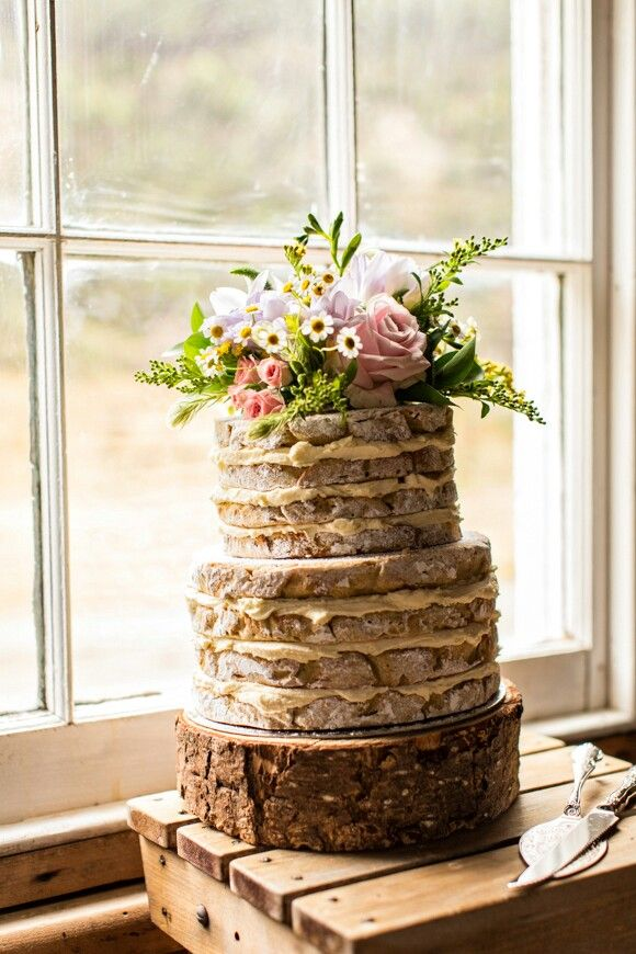 A Rustic Nude Iced Wedding Cake with Flower Topper. Nonas Homemade Cakes x Photograph by Rissa Photography.