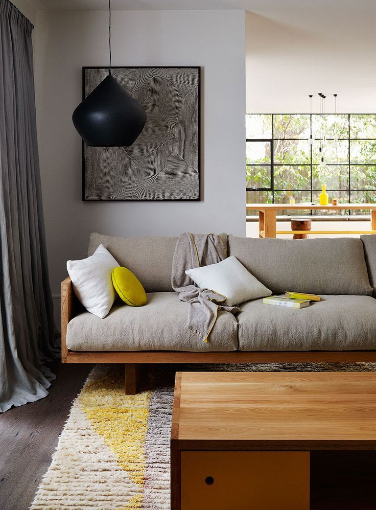 Photography by Lucas Allen for Mark Tuckey via: desire to inspire taupe sofa  grey walls black and yellow accents