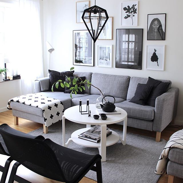 Photo wall with framed posters from Printler, the marketplace for photo art. Lovely gray scale living room, interior design is spot on. Black and white photo art with high contrast.