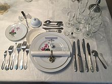 Full course dinner |Silverware is set Parisian style (tines and bowl down).