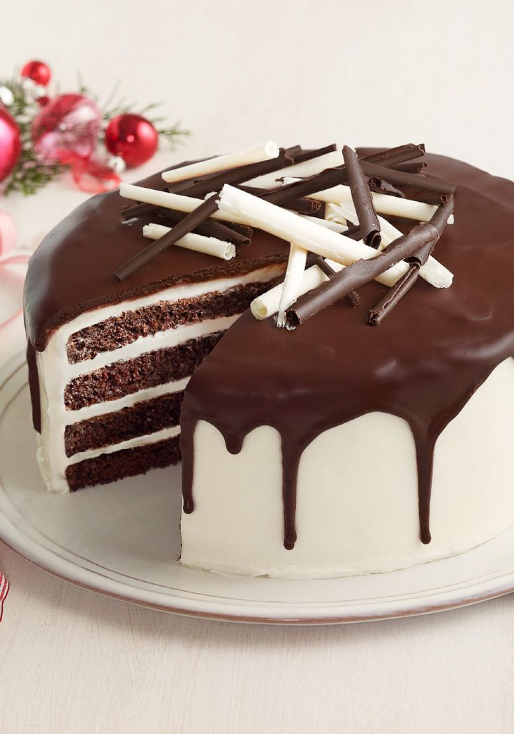 Tuxedo Cake – When the occasion calls for something elegant, this dramatic-looking chocolate Tuxedo Cake with white frosting and chocolate glaze is the one to make!                                                                                                                                                     More