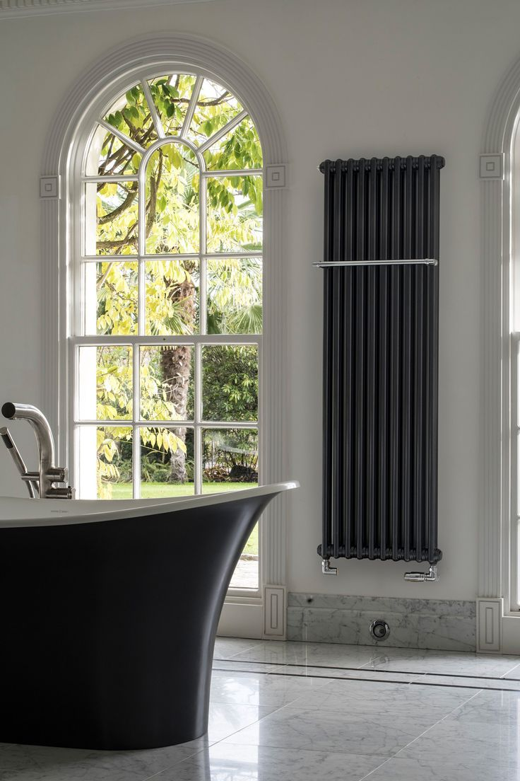 Beautiful black industrial style tall bathroom radiators creating a feature for the home by Bisque Radiators. Designs currently featured over at www.martynwhitedesigns.com