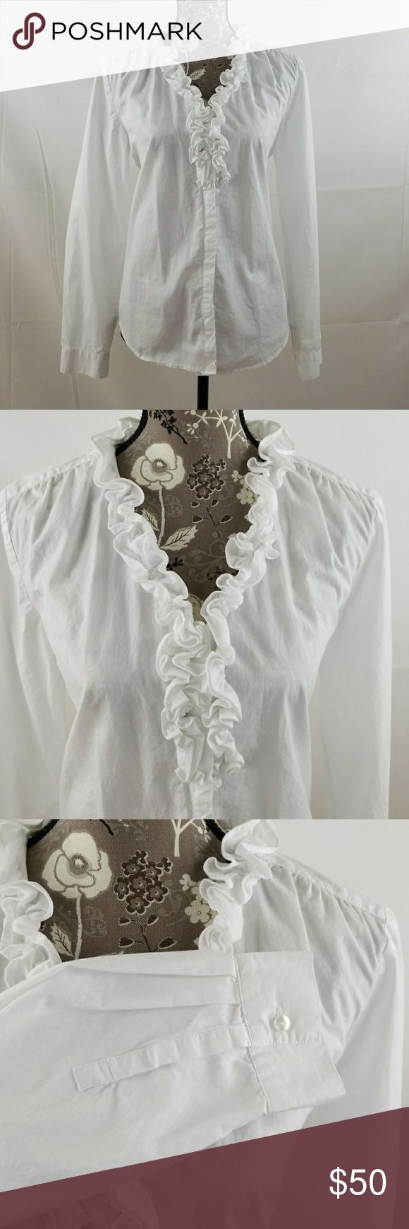 LOFT white ruffle blouse Loft white cotton blouse with ruffles around vneck opening. 19 1\2 in arm pit to arm pit. 25 in. At the longest point. 23in on sides.  100%cotton. 6 button closure. LOFT Tops Blouses
