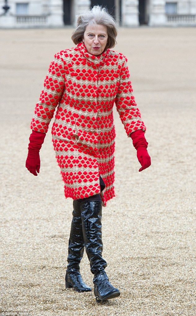 Theresa May, 58, plumps for thigh-high patent leather boots, pictured yesterday as she cru...