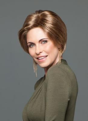 """""""Bobs are the hottest trend of the season, and this playful, rounded bob with free-form layering throughout reflects this trend. Longer lengths on the sides angle down to the chin to add softness and face-framing detail while the lace front monofilament part provides optional off-the-face styling. """""""