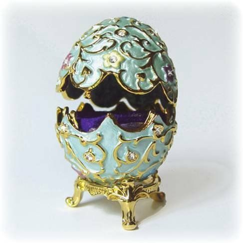 Swarovski Crystals 24K Gold Flowered Blue Faberge Style Egg Box figurine Dazzlers. $33.95. Set with sparkling Swarovski Crystals and meticulously hand enameled by skilled artisans.. Stocked on site! Quick Delivery! (See this item's detailed specifications below.). 3.25 inches tall. Opens to reveal a storage compartment that's completely finished in a glossy enamel.. Certificate of Authenticity included. Limited edition item which is sure to grow in value over ti...