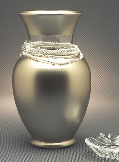 """CHAMPAGNE VASE <3 A classic glass urn is dressed in modern glam! All you need is Modern Metals Champagne Silver Spray Paint, 12"""" glass urn, painter's masking tape, pearl and crystal beads, jewelry wire, clippers... and VOILA!"""