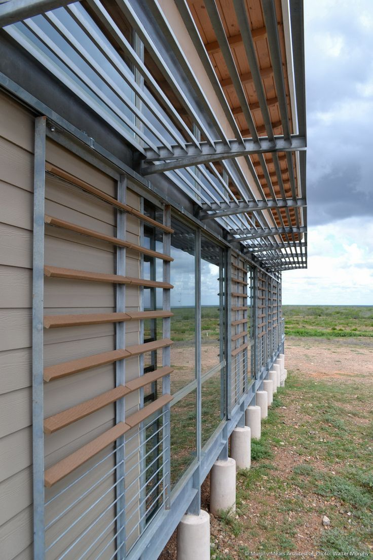 galvanized steel louver awning above rolling shutter with composite wood and steel bars