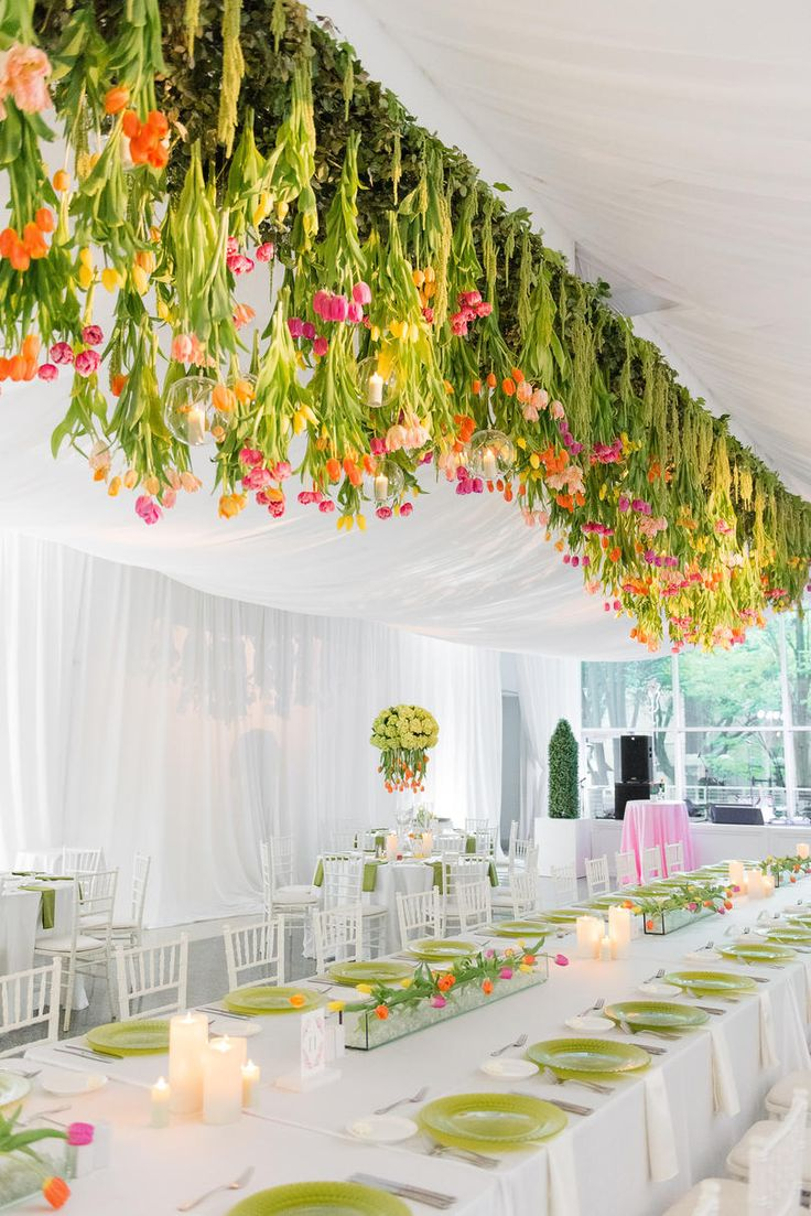 Stem-Filled, Suspended, and Stunning | Stunning tulips and unexpected color stole the show at this Birmingham wedding bash. Ashley walked into wedding planning with a wish for something different, and man oh man did she deliver. Taking inspiration from art deco destinations, she used bubblegum pink and vivid greens in a way only an artist's eye could have envisioned at her reception. The Birmingham Museum of Art was the perfect canvas for Carlos and Ashley's striking, stem-filled…