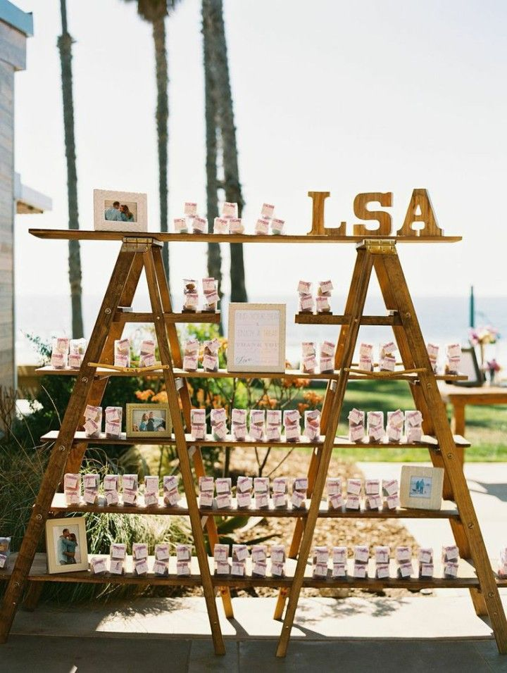Featured Photographer: Carmen Santorelli Photography; Oceanfront California Wedding at Scripps Seaside Forum - wedding favor table display