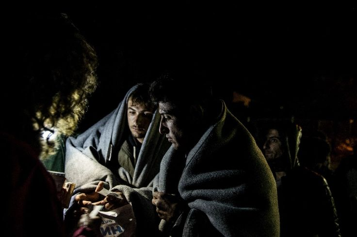Migrants and refugees buy train tickets after crossing the Macedonian-Greek border near GevgelijaMigrants and refugees buy train tickets after cr...